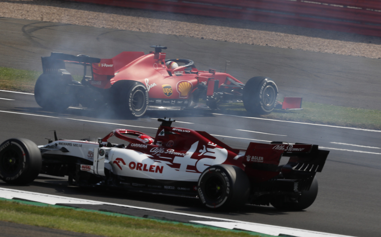 GP 70esimo ANNIVERSARIO, Sebastian Vettel (GER) Ferrari SF1000 spins at the partenza of the race, avoided by Kimi Raikkonen (FIN) Alfa Romeo Racing C39. 09.08.2020. Formula 1 World Championship, Rd 5, 70th Anniversary Grand Prix, Silverstone, England, Gara Day. - www.xpbimages.com, EMail: requests@xpbimages.com - copy of publication required for printed pictures. Every used picture is fee-liable. © Copyright: FIA Pool Image for Editorial Use Only