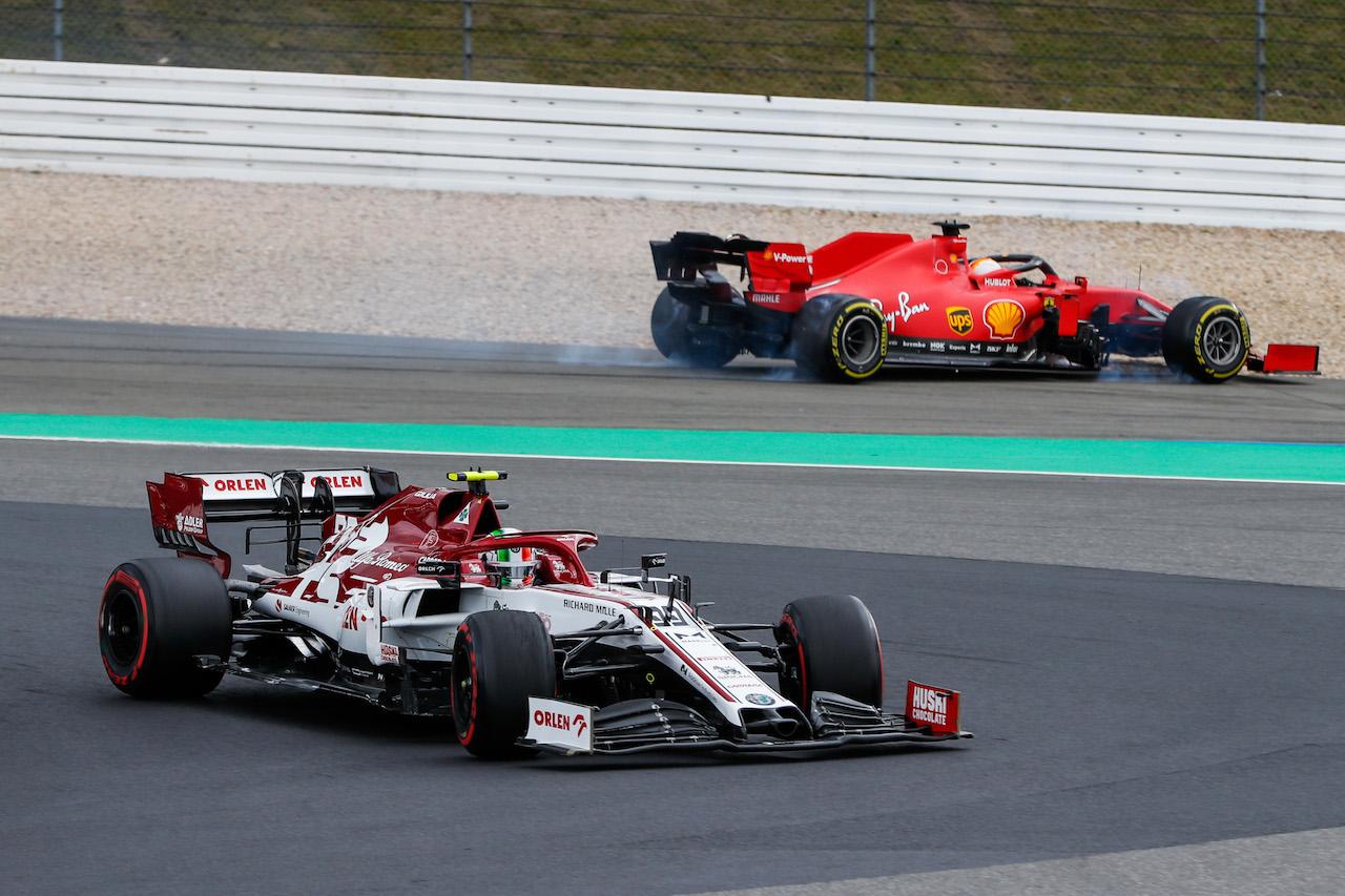 GP EIFEL, Antonio Giovinazzi (ITA) Alfa Romeo Racing C39 passes a spinning Sebastian Vettel (GER) Ferrari SF1000. 11.10.2020. Formula 1 World Championship, Rd 11, Eifel Grand Prix, Nurbugring, Germany, Gara Day. - www.xpbimages.com, EMail: requests@xpbimages.com © Copyright: FIA Pool Image for Editorial Use Only