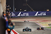 GP BAHRAIN, Gara winner Lewis Hamilton (GBR) Mercedes AMG F1 W12 takes the chequered flag at the end of the race ahead of second placed Max Verstappen (NLD) Red Bull Racing RB16B. 28.03.2021. Formula 1 World Championship, Rd 1, Bahrain Grand Prix, Sakhir, Bahrain, Gara Day. - www.xpbimages.com, EMail: requests@xpbimages.com © Copyright: Moy / XPB Images