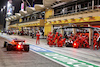 GP BAHRAIN, Lando Norris (GBR) McLaren MCL35M passes as Charles Leclerc (MON) Ferrari SF-21 makes a pit stop. 28.03.2021. Formula 1 World Championship, Rd 1, Bahrain Grand Prix, Sakhir, Bahrain, Gara Day. - www.xpbimages.com, EMail: requests@xpbimages.com © Copyright: Moy / XPB Images