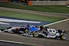 GP BAHRAIN, George Russell (GBR) Williams Racing FW43B e Yuki Tsunoda (JPN) AlphaTauri AT02 battle for position. 28.03.2021. Formula 1 World Championship, Rd 1, Bahrain Grand Prix, Sakhir, Bahrain, Gara Day. - www.xpbimages.com, EMail: requests@xpbimages.com © Copyright: Batchelor / XPB Images