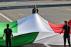 GP ITALIA, Circuit Atmosfera - Large Italian flag held by Lamont Marcell Jacobs (ITA) 2020 Olympic 100m Champion. 12.09.2021. Formula 1 World Championship, Rd 14, Italian Grand Prix, Monza, Italy, Gara Day. - www.xpbimages.com, EMail: requests@xpbimages.com © Copyright: Moy / XPB Images