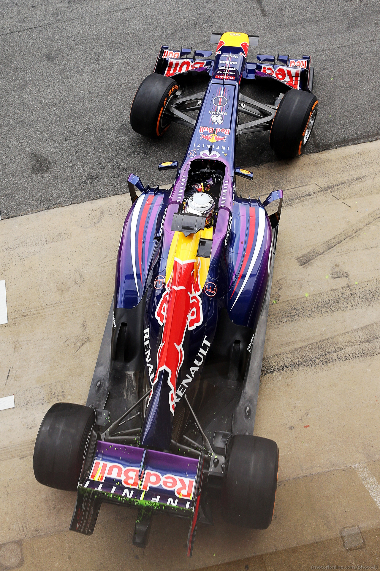 Sebastian Vettel (GER) Red Bull Racing RB9 running flow-vis paint on the rear wing and rear diffuser. 01.03.2013.