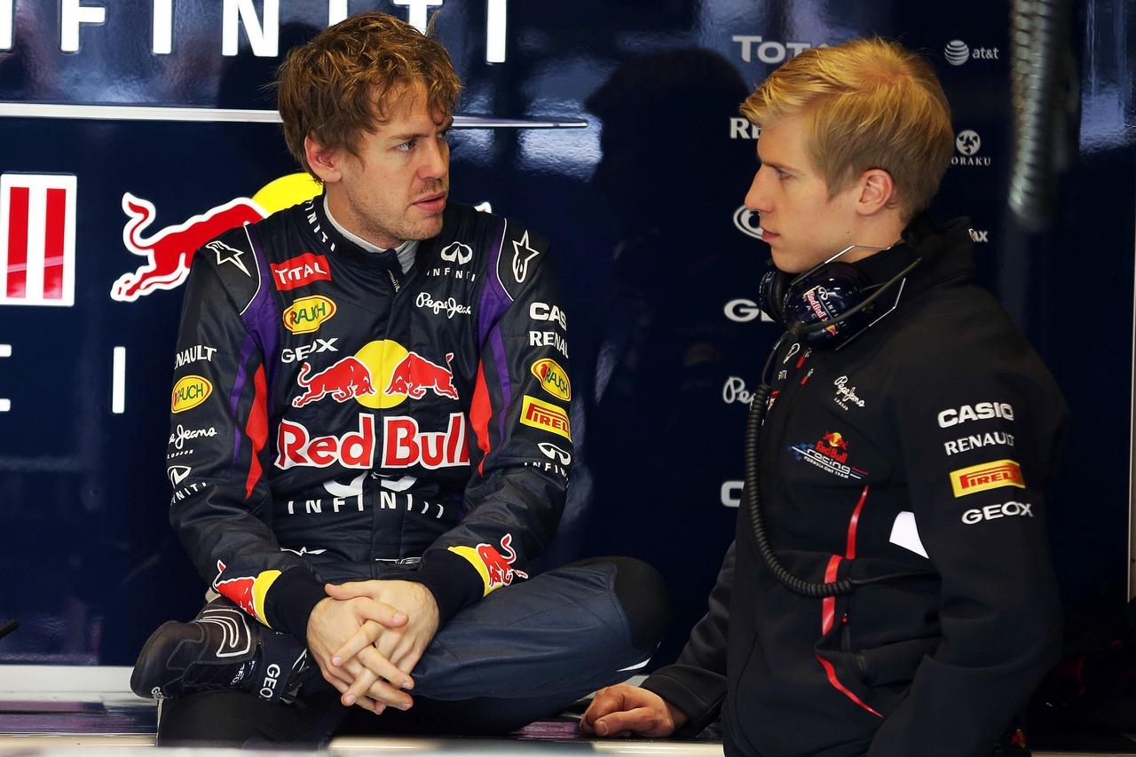 Sebastian Vettel (GER) Red Bull Racing with Heikki Huovinen (FIN) Personal Trainer.