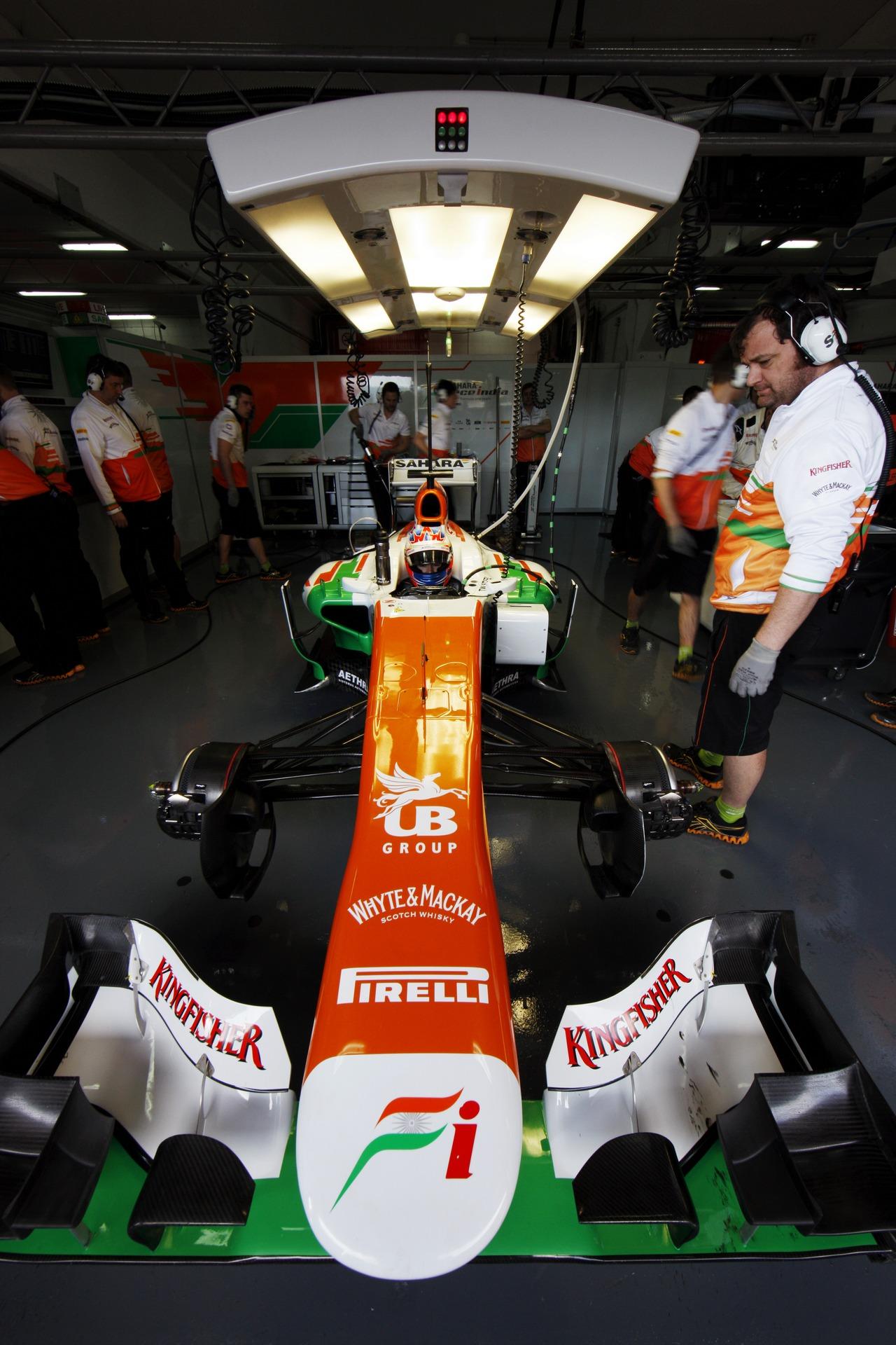 Paul di Resta (GBR) Sahara Force India VJM06 in the pits.