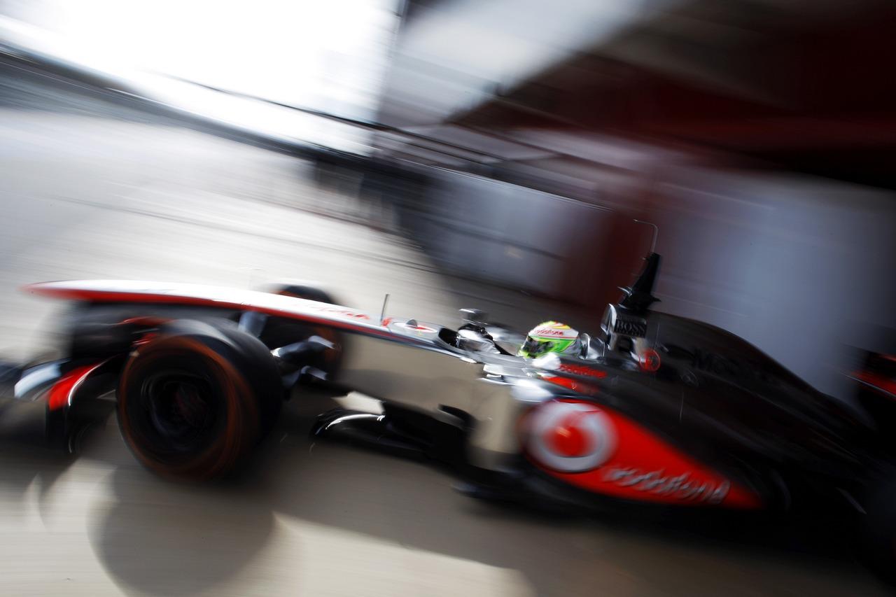 Sergio Perez (MEX) McLaren MP4-28 leaves the pits.