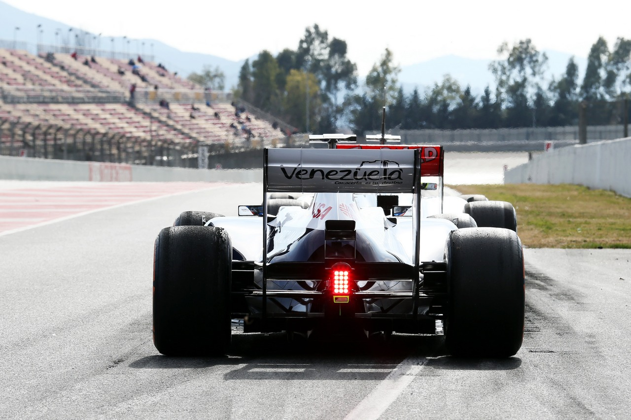 Pastor Maldonado (VEN) Williams FW35 and Sergio Perez (MEX) McLaren MP4-28 at the pit lane exit.