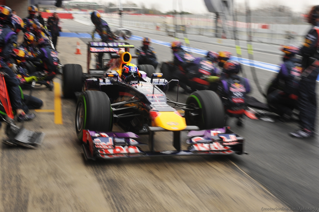Mark Webber (AUS) Red Bull Racing RB9 practices pit stops. 22.02.2013.