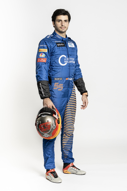 Carlos Sainz holding race helmet side on
