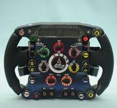 Ferrari: memorabila e giri in pista con un pilota ufficiale all'asta per Telethon
